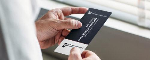 Guy-holding-footballtravel-ticket